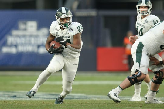 Michigan State running back Elijah Collins runs the ball against Wake Forest during the first quarter of the Pinstripe Bowl at Yankee Stadium, Dec. 27, 2019.
