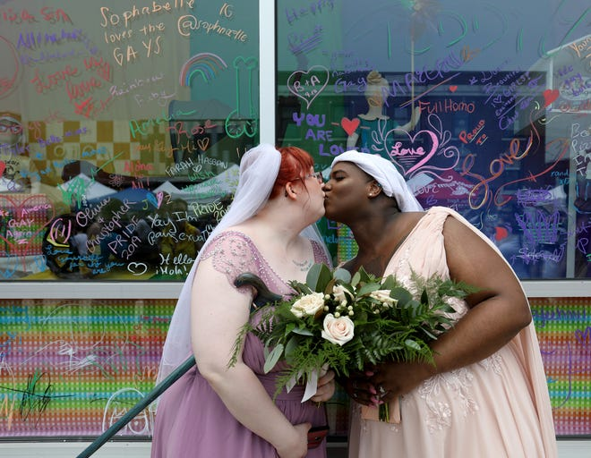 Jem Marko-Zyk, 27 and Tora Brumalis, 27, both from Dearborn, were wed during Ferndale Pride in 2019.