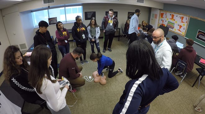 Warren Mott High School students learn life-saving techniques through the Winning Futures program, which exposes young people to careers in healthcare, robotics and more.