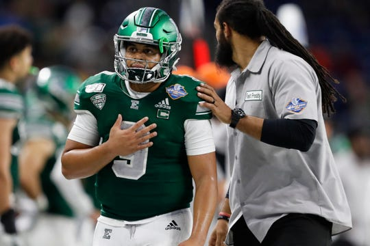 Eastern Michigan Eagles quarterback Mike Glass III (9) walks off the field after being ejected during the fourth quarter against the Pittsburgh Panthers at Ford Field on Dec. 26, 2019..