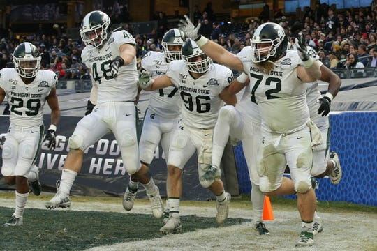 Michigan State defensive tackle Mike Panasiuk (72) celebrates his interception return for a touchdown against Wake Forest during the first quarter of the Pinstripe Bowl at Yankee Stadium, Dec. 27, 2019.