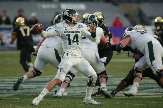 Michigan State quarterback Brian Lewerke passes against Wake Forest during the first quarter of the Pinstripe Bowl at Yankee Stadium, Dec. 27, 2019.