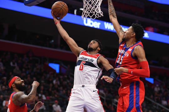 Wizards guard Troy Brown Jr. shoots against Pistons forward Christian Wood in the second quarter at Little Caesars Arena on Thursday.