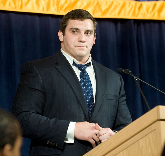 Michigan center David Molk chokes up while talking about his family during the Michigan football bust on Dec. 12, 2011, at Laurel Manor in Livonia.