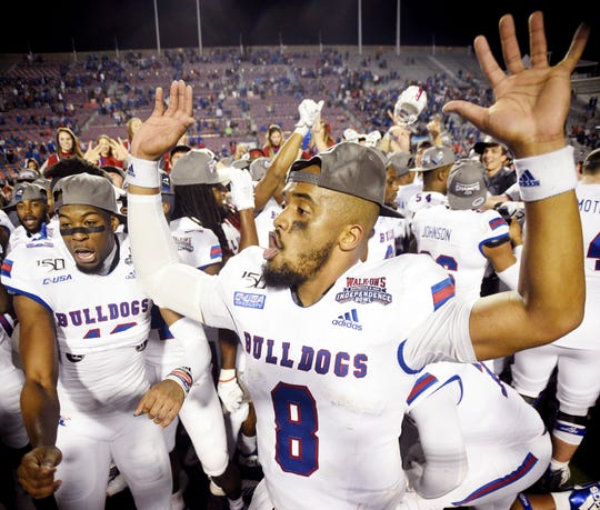 Louisiana Tech's J'Mar Smith celebrates with teammates  after winning Thursday's Independence Bowl against Miami.
