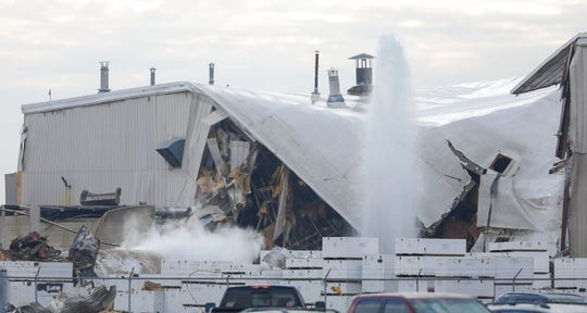 Authorities respond after a partial building collapse at Beechcraft aircraft manufacturing facility in Wichita, Kan., Friday, Dec. 27, 2019. More than a dozen people were injured Friday when a nitrogen line ruptured at the facility, causing part of the building to collapse, authorities said.