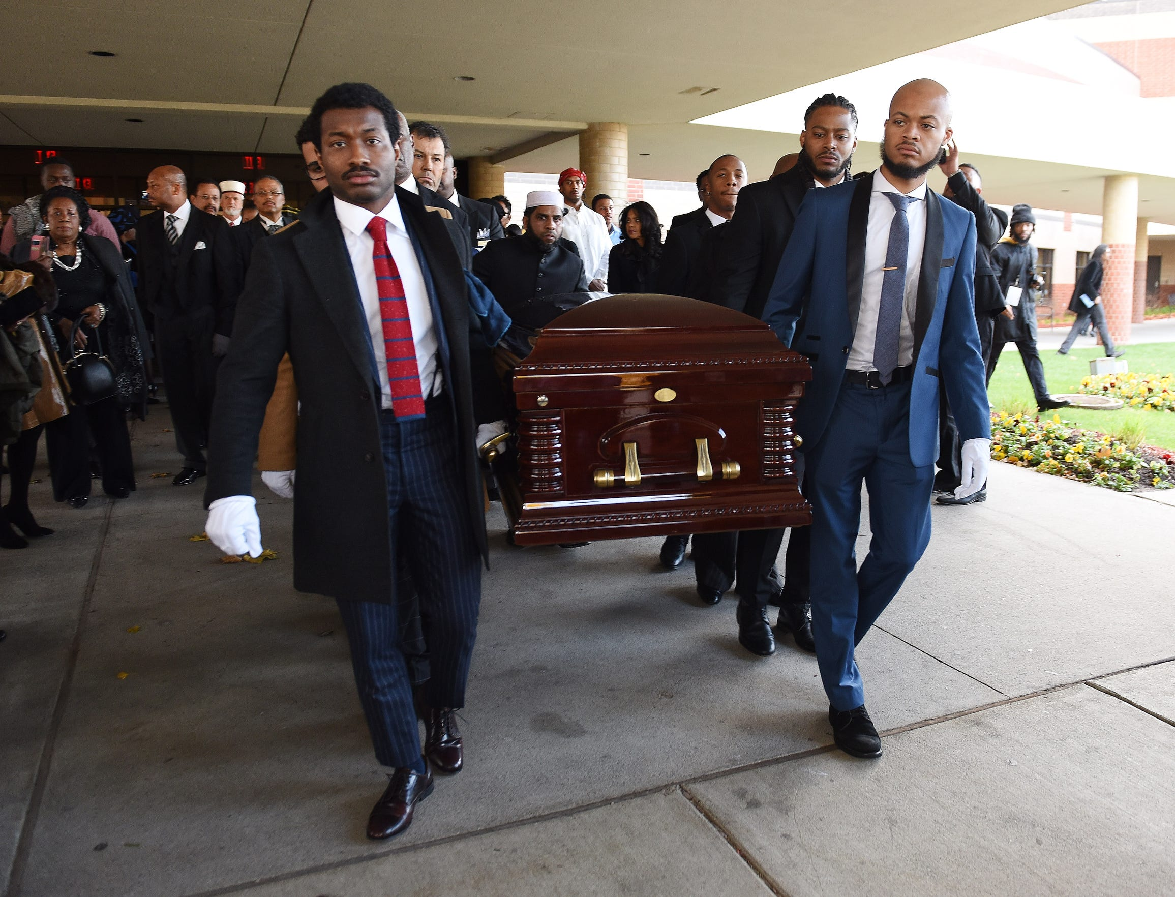 The casket of U.S. Rep. John Conyers Jr. is carried by his sons John Conyers III, left, and Carl Conyers after his funeral at Greater Grace Temple Church., November 4, 2019. Conyers, the longest-serving African-American member of Congress and a civil rights leader died Oct. 27 at age 90.