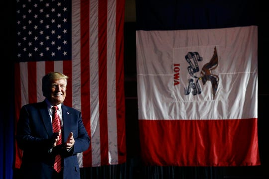 In this June 11, 2019, photo, President Donald Trump arrives to speak at the Republican Party of Iowa's annual dinner in West Des Moines, Iowa, Tuesday. Few states have changed politically with the head-snapping speed of Iowa.