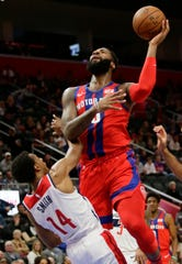Pistons center Andre Drummond (0) shoots against Wizards guard Ish Smith (14) during the first half on Thursday.