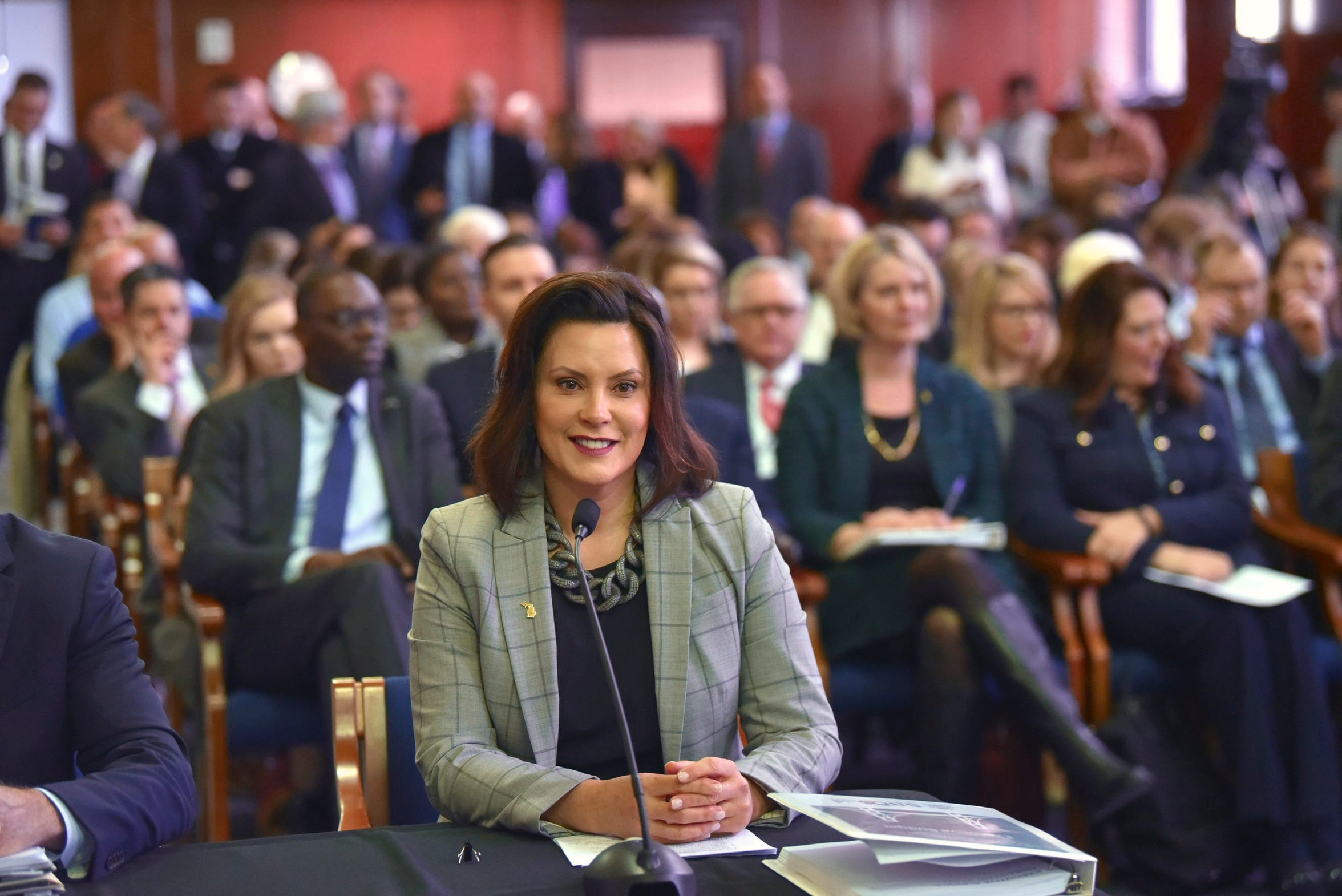 Gov. Gretchen Whitmer presents her fiscal year 2020 budget proposal to lawmakers during a joint meeting of the House and Senate appropriations committees in the Senate Hearing Room at the state capitol in Lansing, March 5, 2019.