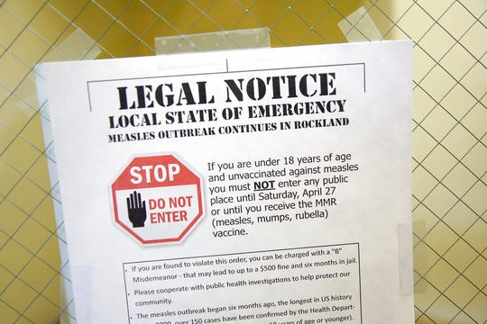 A sign at the Rockland County Health Department in Pomona, N.Y., explains the local state of emergency regarding a March measles outbreak. There were nearly 1,300 case of measles in the U.S. through November 2019 - the largest number in 27 years.