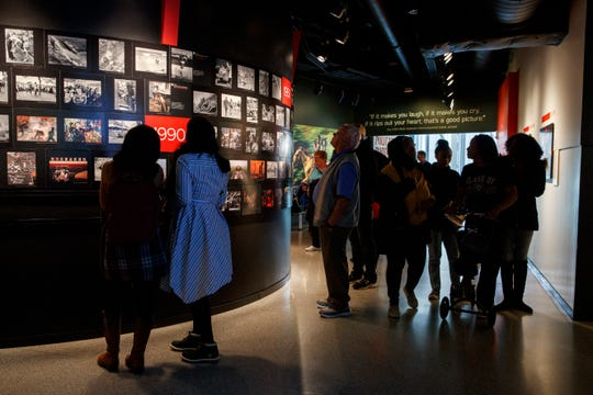People visit the Pulitzer Prize Photography exhibition at the Newseum on Dec. 20.