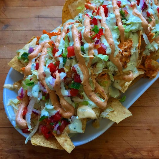 Buffalo chicken nachos from Bobcat Bonnie's, which is opening a new location in February at Partridge Creek.