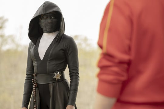 "Regina King as Sister Night in ""Watchmen."""