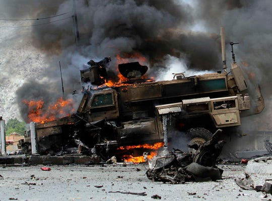 Smoke billows from a burning NATO vehicle following a suicide attack which hit a military convoy in Jalalabad, Afghanistan, in this June 6, 2010, file photo.