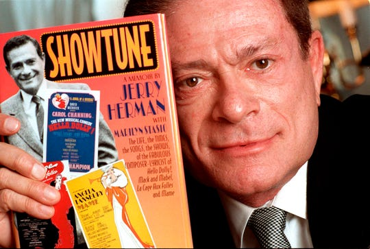 "Cmposer Jerry Herman displays his book ""Showtune,"" in New York in 1996."
