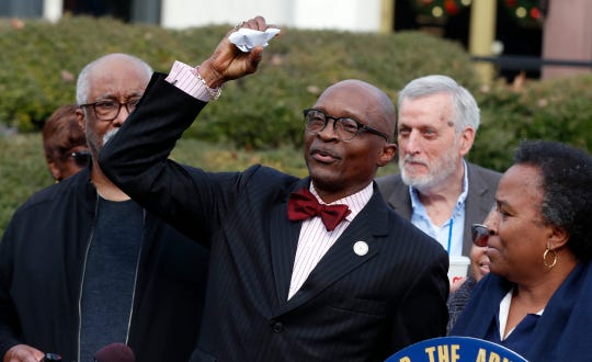 The Rev. T. Anthony Spearman, president of the NC NAACP, crumples up a mailer that tells voters IDs are needed in the upcoming 2020 election during a press conference outside the Legislative Building in Raleigh, N.C., Friday, Dec. 27, 2019.
