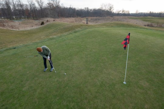 """Jack Considine of Troy putts on the first hole at Sanctuary Lake golf course in December, one of the months that helped push Metro Detroit into ninth position among the top 10 warmest for """"meteorological winter"""" months of December through February, the National Weather Service says."""