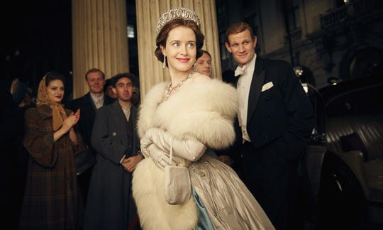 """Claire Foy, center, and Matt Smith, right, in a scene from """"The Crown."""""""