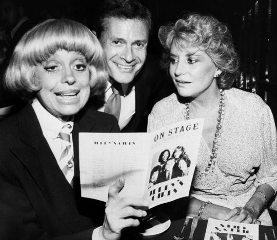 Carole Channing, left, and television personality Barbara Walters look over the program with composer-lyricist Jerry Herman at a Broadway Theater on Sept. 1, 1981.