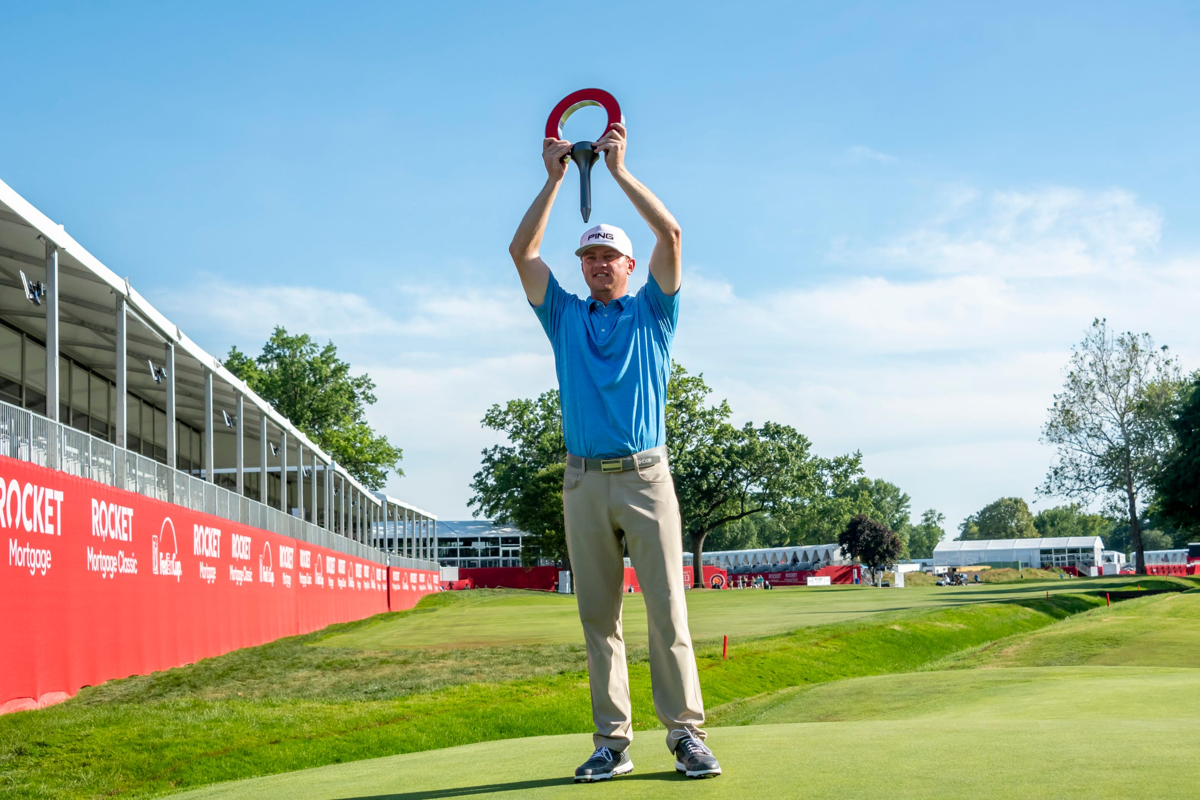 Nate Lashley holds the trophy after winning the Rocket Mortgage Classic golf tournament at the Detroit Golf Club in June.