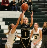 Ashlee Volpe of Corning goes up for a shot in between Binghamton Seton Catholic Central's Kathryn Lathrop (left) and Emily Dempsey during a girls quarterfinal at the Josh Palmer Fund Elmira Holiday Inn Classic on Dec. 27, 2019 at Elmira High School. Friday was the first day for the four-day tournament.