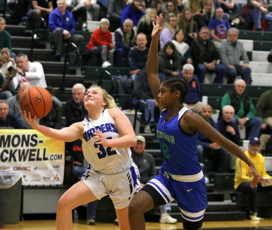Maddie Johnson of Horseheads goes up for a layup as Twanasia Graves of Inwood Academy tries for the block in the Blue Raiders' 60-17 win in a girls quarterfinal at the Josh Palmer Fund Elmira Holiday Inn Classic on Dec. 27, 2019 at Elmira High School.