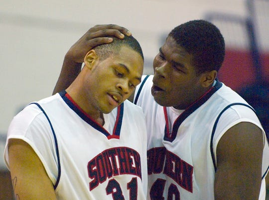 USI's Brandon Carr (31) is offered a little support from teammate Jeron Lewis (40) after Carr was fouled while shooting during their game of the GLVC Men's Basketball Tournament at the Physical Activities Center.
