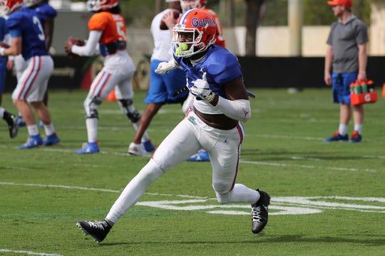 Florida Gators wide receiver Van Jefferson runs drills during an NCAA college football practice on Thursday, Dec. 26, 2019, in Miami Shores, Fla. Florida plays Virginia in the Orange Bowl on Dec. 30.