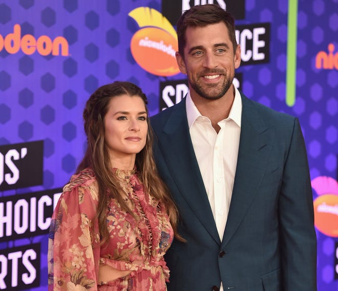 Danica Patrick and Aaron Rodgers attend the Nickelodeon Kids' Choice Sports 2018.
