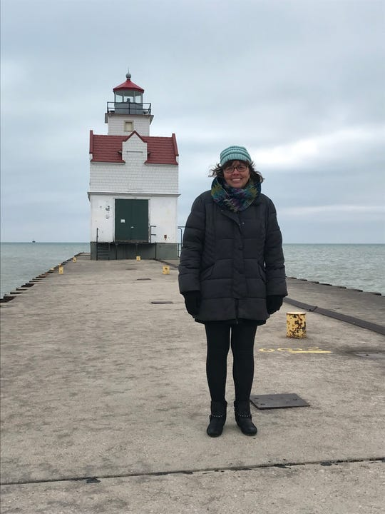 Robin Nelson stands outside the Kewaunee Pierhead Lighthouse for which she led fundraising efforts for its renovation to historical standards. The lighthouse opened for tours on two weekends this summer.