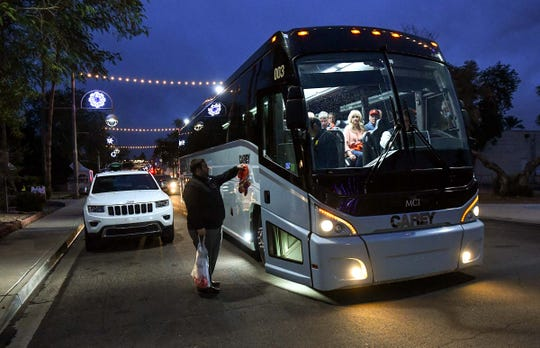 An Anthony Travel bus with Clemson football fans arrive for a party at The Tortilla Factory in Scottsdale, Arizona Thursday December 26, 2019.