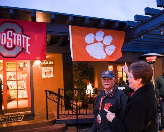 Jim Welborn, left, and Mary Welborn of Anderson visit The Tortilla Factory for a Clemson football fan party in Scottsdale, Arizona Thursday December 26, 2019.