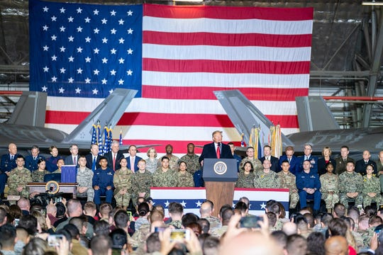 President Donald J. Trump and first lady Melania Trump participate in remarks and signing ceremony Dec. 20 for the National Defense Authorization at Andrews Air Force Base.
