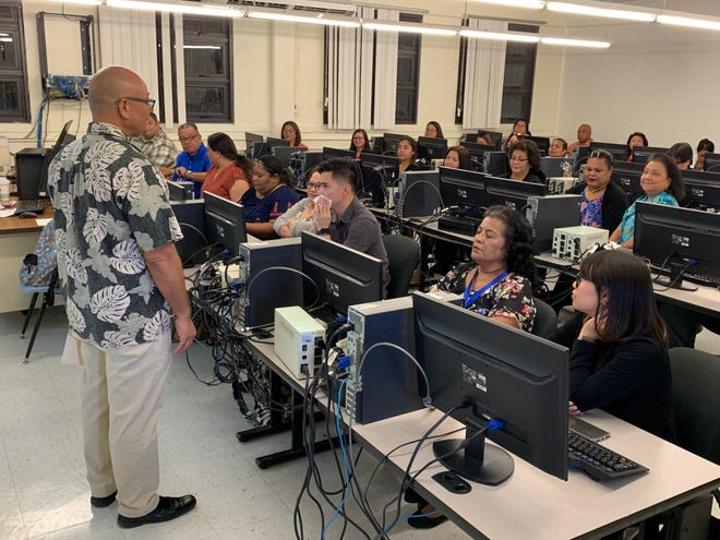 Guam Department of Labor acting Director Gerard Toves addresses the trainees of the online case management system, part of a grant meant to better serve dislocated workers, the Reemployment & Systems.