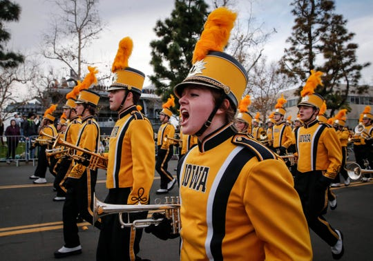 Members of the Iowa Hawkeyes Marching Band perform during the Holiday Bowl parade on Thursday, Dec. 26, 2019, in San Diego, Calif.
