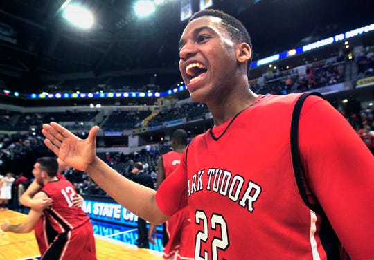 Park Tudor's Trevon Bluiett celebrates as time expires and the Panthers win the Class 2A IHSAA boys basketball state title in an 84-57 win over the Westview at Bankers Life Fieldhouse, March 29, 2014.