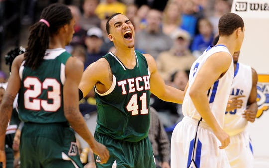 Tech forward Trey Lyles celebrates a dunk against Lake Central during the Class 4A IHSAA boys basketball championship inside Bankers Life Fieldhouse,, March 29, 2014, in Indianapolis. Tech won the game 63-59.