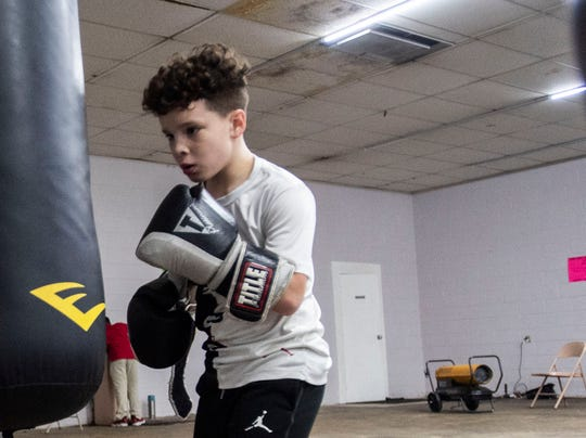 Nathan Hopper, 10 practices his punches on a punching bag in Ingram-Rayford Collin's gym in Jackson, Tenn.,Tuesday Dec. 17. Hopper was named Best Fighter of the night for the 9-10 year olds 80 lb division at the Tennessee State Silver Gloves.