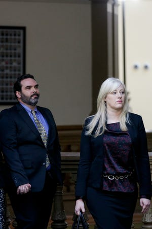 Michael Barnett, left, and ex-wife, Kristine Barnett, walk out of Superior 2 after a pretrial conference with Judge Steven Meyer, Friday, Dec. 27, 2019 at the Tippecanoe County Courthouse in Lafayette. The Barnetts are accused of abandoning their adoptive daughter in Lafayette in 2013.