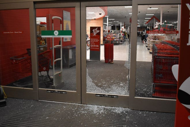 A broken glass door at the Target store in Brighton after an early morning break-in, on Friday, Dec. 27, 2019.