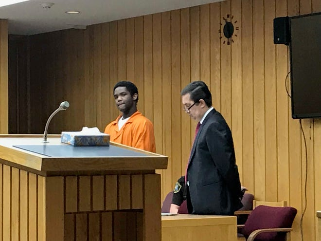 Neal Prince, left, stands next to his attorney, David Carter, during his sentencing hearing for first-degree murder.