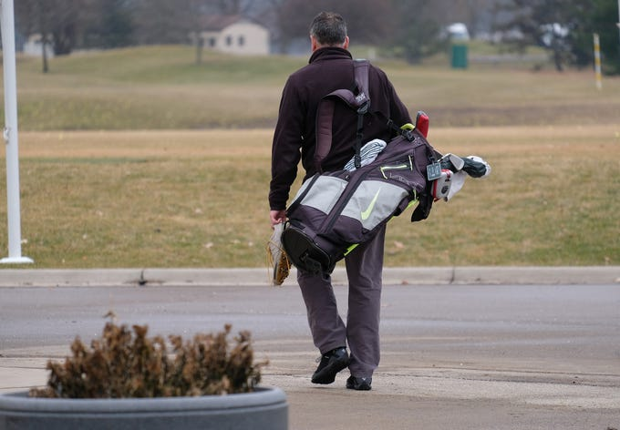 A man gets ready to get in some winter golfing practice at Forest Akers Golf Course Friday, Dec. 27, 2019.