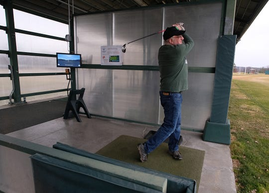Randy Marwede from Lansing, takes advantage of the weather Friday, Dec. 27, 2019 to drive a few balls and stay in shape at the Forest Akers driving range.