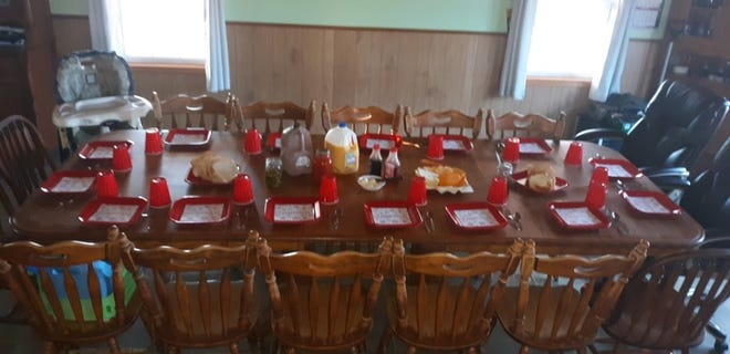 The dining table is set and ready for the Eicher family's breakfast the morning of their Christmas gathering. Everyone spent the night at Joe and Lovina's and began their day of celebration eating breakfast together around the family table.