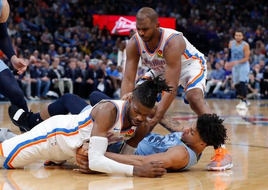 Oklahoma City Thunder center Nerlens Noel (9), guard Chris Paul (3) and Memphis Grizzlies forward Brandon Clarke (15) battle for the ball during the second half Thursday, Dec. 26, 2019, in Oklahoma City.