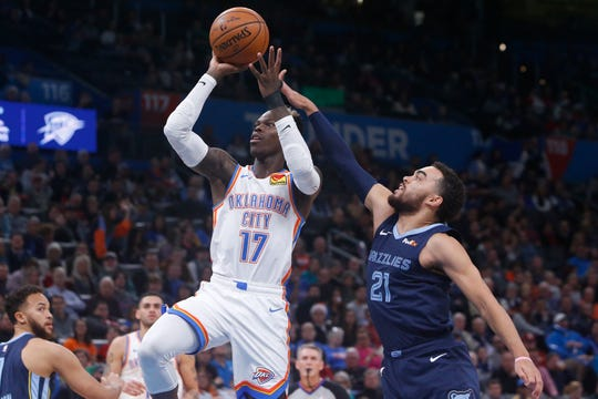 Oklahoma City Thunder guard Dennis Schroder (17) shoots in front of Memphis Grizzlies guard Tyus Jones (21) in the first half of an NBA basketball game Wednesday, Dec. 18, 2019, in Oklahoma City. (AP Photo/Sue Ogrocki)