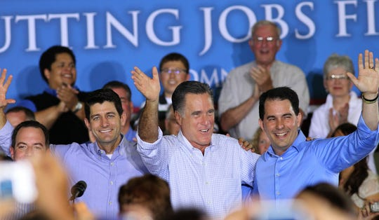 """Wisconsinites (from left) Reince Priebus, Paul Ryan and Scott Walker (right) share the stage with Mitt Romney during a campaign stop in 2012. At the time, the """"Big Three"""" were building what became known as the Cheesehead Revolution in the Republican Party."""