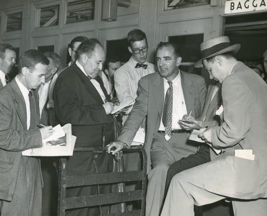 Sen. Joseph McCarthy speaks with reporters at La Guardia Airport in New York City shortly after his victory over Len Schmitt in the 1952 Wisconsin Republican primary.