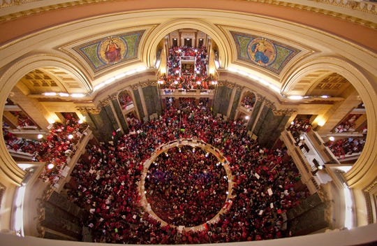 Union workers, teachers and other protesters showed up for weeks at Wisconsin's Capitol in protest of Gov. Scott Walker's budget repair bill, later known as Act 10, which reduced public sector union workers' benefits and eliminated collective bargaining rights for many of them.